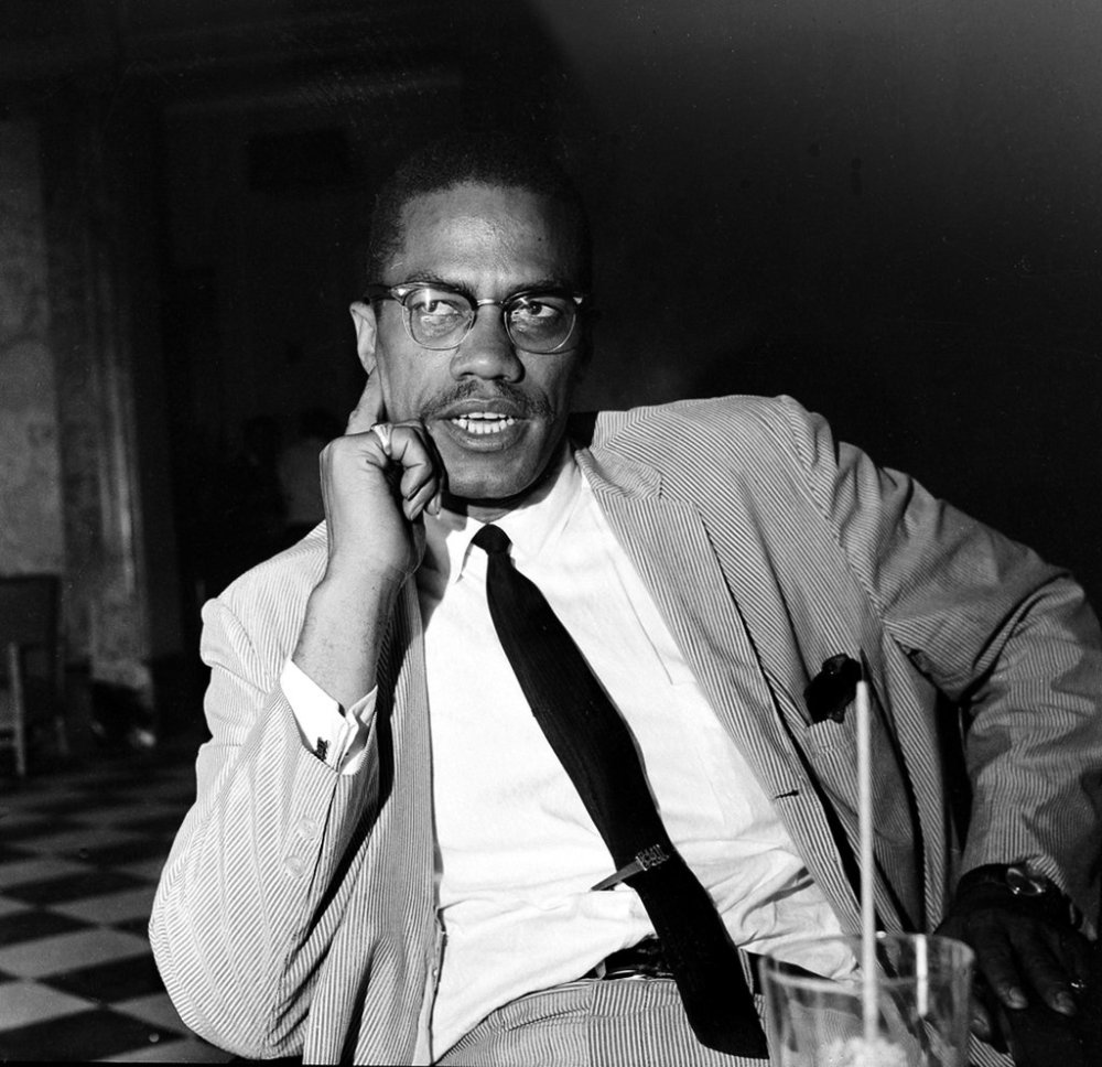 Malcolm X seated